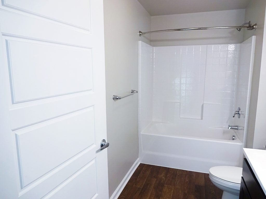 Full-size bathroom in October Station apartment building